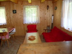 Kuchyňský kout s odpočinkovým prostorem - chata k pronájmu